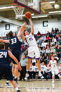 BG Senior Forward #15 Nick Scaramozzino puts back an offensive rebound over Hollidaysburg Senior Center #33 Casey Ottaway.