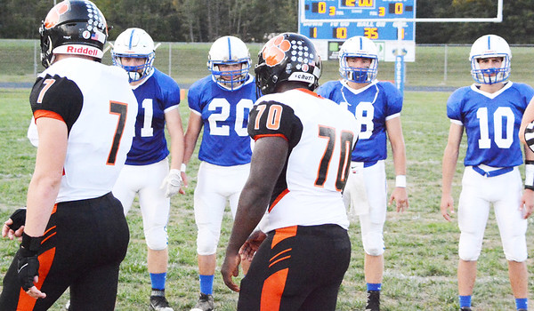 Christopher Aune | The Herald-Tribune<br /> Team leaders Ethan Hirt (left), Bret Williamson, Peyton Meyer and Nathan Kirschner face off with heavy hitters of the Tigers' team prior to the start of the game.