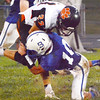 Christopher Aune | The Herald-Tribune<br /> In the second half, Batesville Nathan Kirschner got low enough for a solo tackle on Tigers' wide receiver Ben Murphy.