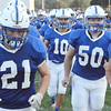 Christopher Aune | The Herald-Tribune<br /> Ethan Hirt (21) and Brett Williamson (20) led the Batesville Bulldogs onto the field to a salute by the school band.