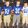 Up-and-coming football players keep a clean ball close to the action at all times as 2016 ball boys.