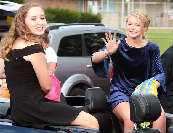 Will Fehlinger | The Herald-Tribune<br /> Tori Kurtz (waving) and Chloe Shaw were two of five Batesville High School seniors up for homecoming queen 2018. The title went to Caitlynn Werner at halftime of BHS' win over Lawrenceburg.