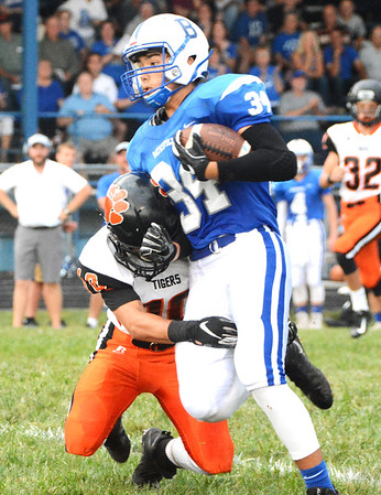 Will Fehlinger | The Herald-Tribune Batesville's Charlie Dice shakes off a Lawrenceburg defender on his way to a long touchdown reception early in BHS' homecoming win over the Tigers.