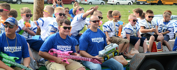 "Will Fehlinger | The Herald-Tribune<br /> A float of Batesville Youth Football players and their coaches ""rock out"" during the BHS homecoming parade Friday, Sept. 21."