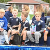 Will Fehlinger | The Herald-Tribune<br /> Young Batesville soccer players distribute candy during the annual homecoming parade Friday afternoon.