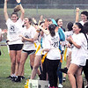 Will Fehlinger | The Herald-Tribune<br /> The junior girls were triumphant at a soggy powder puff football game Friday afternoon at the Dawg Pound.