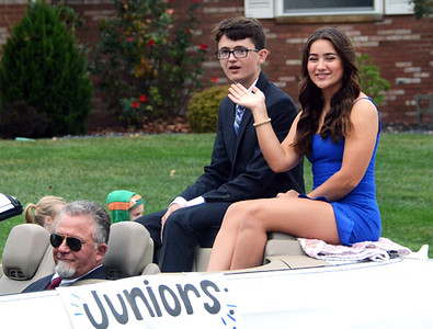Will Fehlinger | The Herald-Tribune Juniors Dillon Murray and Olive Cerniglia salute the crowd during the annual homecoming parade Friday. The pair would later be named prince and princess for 2019.