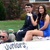 Will Fehlinger | The Herald-Tribune<br /> Juniors Dillon Murray and Olive Cerniglia salute the crowd during the annual homecoming parade Friday. The pair would later be named prince and princess for 2019.
