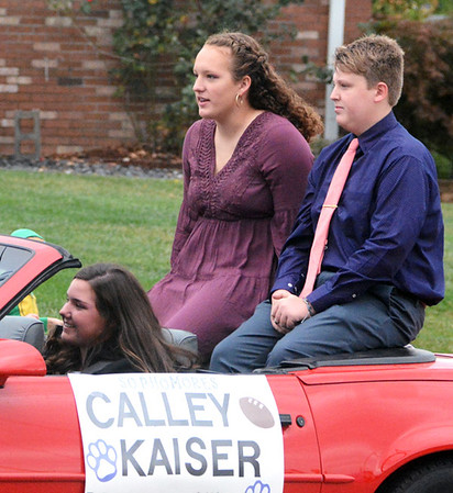 Will Fehlinger | The Herald-Tribune<br /> Sophomores Calley Kaiser and Will Thomas ride along the parade route Oct. 11 in Batesville.