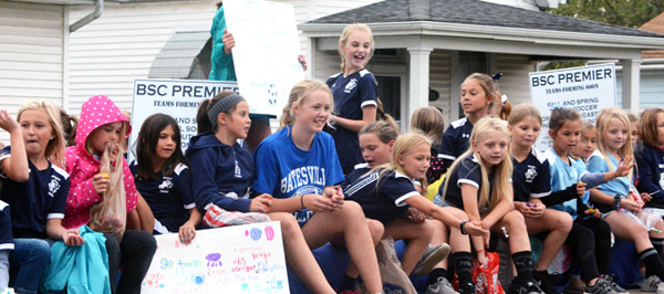 Will Fehlinger | The Herald-Tribune<br /> Girls from Batesville Soccer Club Premier travel the parade route Friday in downtown Batesville.