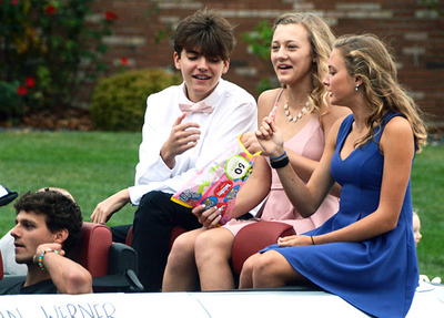 Will Fehlinger   The Herald-Tribune Alec Bunselmeier, Cayman Werner and Ava Hanson (from left) represent the Class of 2023 at the annual homecoming parade.