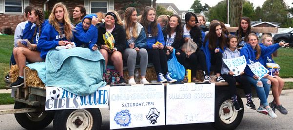 Will Fehlinger | The Herald-Tribune<br /> Batesville High School's girls soccer team crowds onto a float for the homecoming parade Oct. 11. The next day, the girls were part of four sectional titlists for the school in one day, along with boys soccer and both cross country teams.