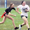 Will Fehlinger | The Herald-Tribune<br /> Rebecca Deputy reaches for Paige Oldham's flag during the powder puff football game Friday afternoon.