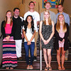Christopher Aune | The Herald-Tribune<br /> Senior king candidates are (back row from left) Nick Jacobs, Connor Schuck, Cole Nuhring and Wyatt Schebler. In the running for queen are (front row) Kelli Hartman, Abby Brandt, Rachel Merkel and Emily Rose.