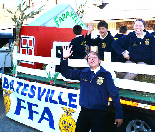 Christopher Aune | The Herald-Tribune<br /> Club members proudly display the Farmville float they created.