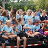 Will Fehlinger | The Herald-Tribune<br /> Batesville Premier Soccer Club athletes toss out candy at Friday's homecoming parade.
