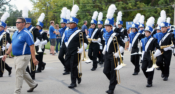 Will Fehlinger | The Herald-Tribune<br /> Director Eric Stauffer leads the Batesville High School Bulldog Brigade at the front of the homecoming parade lineup.