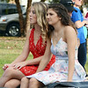 Will Fehlinger | The Herald-Tribune<br /> Homecoming court candidates Sophie Brown, left, and Maddie Pierson take a ride along the parade route.