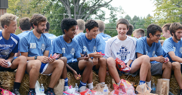 Will Fehlinger | The Herald-Tribune<br /> Members of the BHS boys soccer team pass out treats. The team was crowned sectional champs the next day.