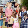 Will Fehlinger | The Herald-Tribune<br /> A young girl shows off her candy haul to friends following the homecoming parade.