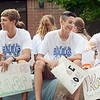 Will Fehlinger | The Herald-Tribune<br /> Batesville's boys cross country team members ride in the homecoming parade Oct. 6. The boys would win sectional the following day.