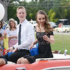 Will Fehlinger | The Herald-Tribune<br /> Madison Chambers and Jacob Nobbe greet parade-goers Friday evening. The pair were candidates for homecoming prince and princess.