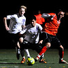 Boulder Panther's Walter Bertini (21) and Max Jaffee (16) try to obtain possession of the ball from Fairview Knight's Shane O'Neill (2) during their game at Recht Field in Boulder Thursday, Sept. 24, 2009.<br /> <br />  DAILY CAMERA/ Kasia Broussalian