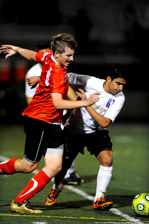 Boulder Panther's Angel Valle (10) and Fairview Knight's Tim Jozwiak (13) battle for the ball during their game at Recht Field in Boulder Thursday, Sept. 24, 2009.<br /> <br />  DAILY CAMERA/ Kasia Broussalian