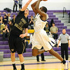 BHS09<br /> Boulder's Johnoy Albert shoots over Austin Maag of Ft. Collins.<br /> Photo by Marty Caivano/Camera/Feb. 19, 2010