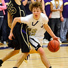 BHS05<br /> Boulder's Riley Grabau drives around Cody Spicer of Ft. Collins.<br /> Photo by Marty Caivano/Camera/Feb. 19, 2010