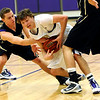 BHS08<br /> Boulder's Riley Grabau fights for the ball with Merrick Kelley, left, and Hayden Wood of Ft. Collins.<br /> Photo by Marty Caivano/Camera/Feb. 19, 2010