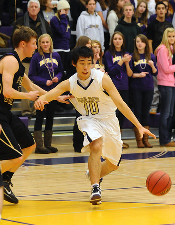 BHS03<br /> Boulder's Min Sung escapes pressure from Ben Marum of Ft. Collins.<br /> Photo by Marty Caivano/Camera/Feb. 19, 2010