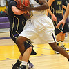 BHS07<br /> Boulder's Johnoy Albert gets tangled up with Austin Maag of Ft. Collins.<br /> Photo by Marty Caivano/Camera/Feb. 19, 2010