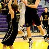 BHS01<br /> Boulder's Ethan Baker is heavily blocked by Ben Marum, left, and Greg Svitavsky of Ft. Collins.<br /> Photo by Marty Caivano/Camera/Feb. 19, 2010
