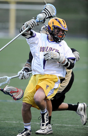 LACROSSE<br /> Boulder's Sean McCarthy evades Monarch's Ethan LaHoda.<br /> Photo by Marty Caivano/Camera/April 5, 2010