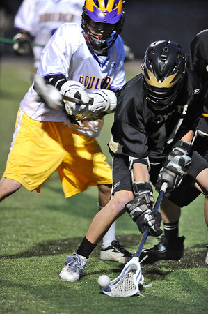 LACROSSE<br /> Monarch's Dillon Vendetti gets possession of the ball ahead of Eric Seward of Boulder.<br /> Photo by Marty Caivano/Camera/April 5, 2010