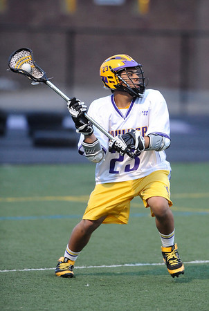 LACROSSE<br /> Boulder's Juan Ramirez looks to pass against Monarch.<br /> Photo by Marty Caivano/Camera/April 5, 2010