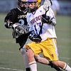 LACROSSE<br /> Boulder's Trevor Larson is pursued by Dylan Ritger of Monarch.<br /> Photo by Marty Caivano/Camera/April 5, 2010