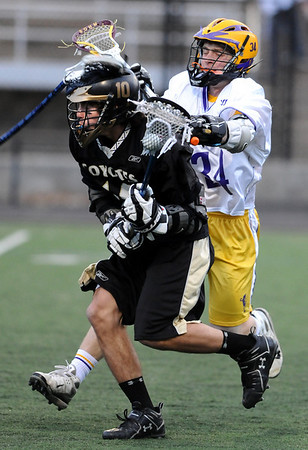 LACROSSE<br /> Monarch's Nathan Puldy is pressured by Griffin Bohm of Boulder.<br /> Photo by Marty Caivano/Camera/April 5, 2010