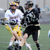 LACROSSE<br /> Monarch's Dylan Ritger is pursued by Griffin Bohm of Boulder.<br /> Photo by Marty Caivano/Camera/April 5, 2010