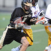 LACROSSE<br /> Monarch's Tyler Thorson pushes past Boulder defenders.<br /> Photo by Marty Caivano/Camera/April 5, 2010