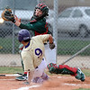 BASEBALL06.JPG BASEBALL<br /> Boulder's Cisco Medina slides into home plate against Ismael Toledo of Smoky Hill.<br /> Photo by Marty Caivano/Camera/March 31, 2010