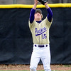 BASEBALL02.JPG BASEBALL02<br /> Center fielder Dylan Platt catches his second of two fly balls.<br /> Photo by Marty Caivano/Camera/March 31, 2010
