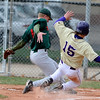 BASEBALL07.JPG BASEBALL<br /> Boulder's Dylan Platt nearly collides with Matt Ogden at home plate.<br /> Photo by Marty Caivano/Camera/March 31, 2010