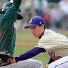 BASEBALL09.JPG BASEBALL<br /> Smoky Hill's Steven Cox evades a tag by Boulder's Blake Partridge at third base.<br /> Photo by Marty Caivano/Camera/March 31, 2010