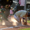 BASEBALL12.JPG BASEBALL<br /> Boulder's Walker Henry scores the winning run against Smoky Hill by evading catcher Ismael Toledo.<br /> Photo by Marty Caivano/Camera/March 31, 2010