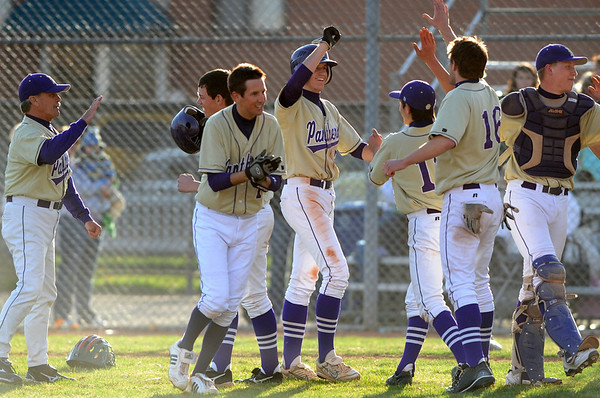 BASEBALL13.JPG BASEBALL<br /> Boulder players celebrate their last-minute win against Smoky HIll.<br /> Photo by Marty Caivano/Camera/March 31, 2010