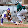 BASEBALL03.JPG BASEBALL<br /> Boulder's Drew Noolas is just seconds too late to tag out Zach Bothwell of Smoky Hill.<br /> Photo by Marty Caivano/Camera/March 31, 2010
