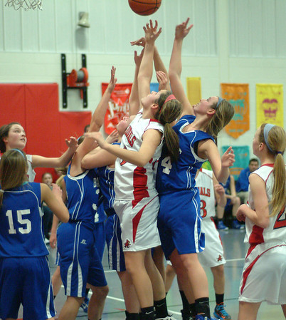 Staff photo by Bryan Helvie<br /> Everybody wants it: Players from both teams converge on a rebound in the first half.