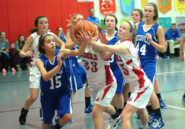 Staff photos by Bryan Helvie<br /> Loose ball: St. Louis eighth grade players Audrey Weigel (25) and Baylee Rohlfing (33) try to grab the rebound before Batesville's Taylor Rowlett (15) gets her hands on it.